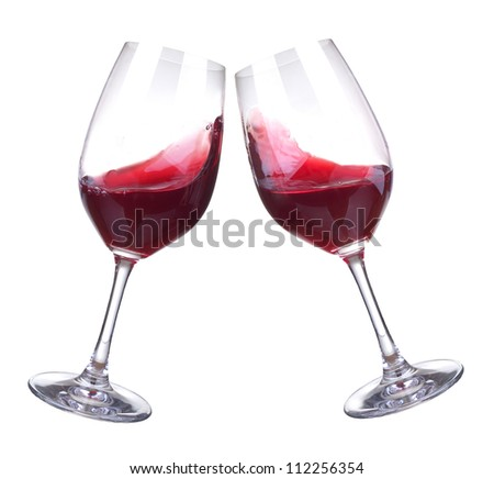 Stemware with red wine. Abstract drink composition - stock photo