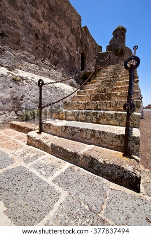 step arrecife  drawbridge  lanzarote  spain the old wall castle  sentry tower and door  in teguise   - stock photo