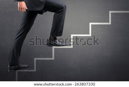 Step. Businessman climbing the career stairs drawn on a chalkboard with copy space - stock photo