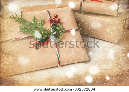 step by step photo decoration New Year gift ribbons, branches and berries, fir branch, colorful ribbons, cones and nuts on an old wooden board, rozhdestveskaya card, toned image, selective focus - stock photo