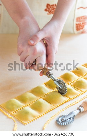 Step by step process of making home-made ravioli or tortellini with spinach and ricotta filling. See series - stock photo