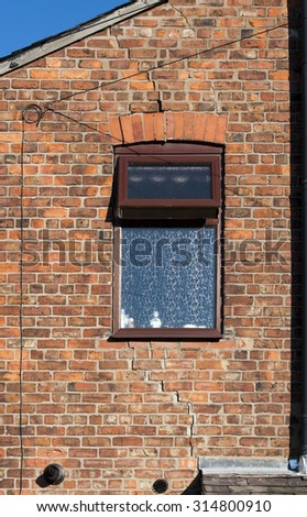 step cracking to a brick house caused by subsidence - stock photo