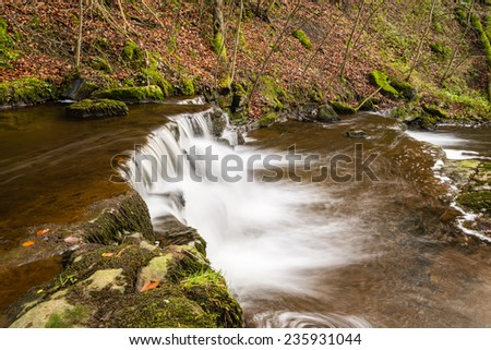 Step in the Scaleber Force Waterfall / Scaleber Force or Foss waterfall near Settle in the Yorkshire Dales National Park - stock photo