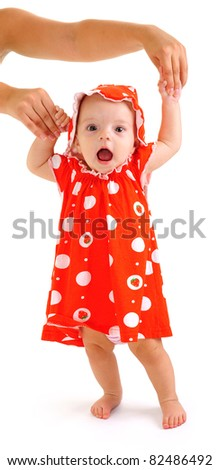 step of child.little girl on a white background.walk
