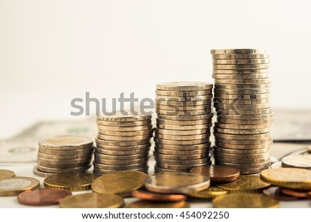 step of golden coins stacks on table, money, saving and investment concept