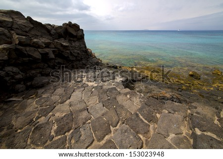 step pier rusty chain  water  boat yacht coastline and summer in lanzarote spain  - stock photo