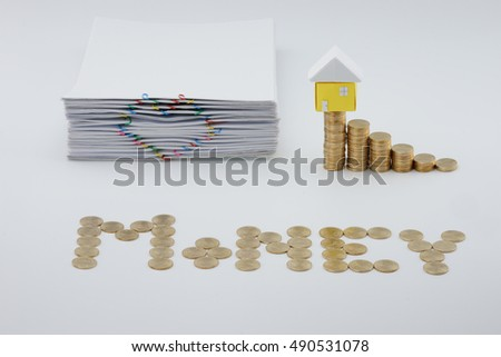 Step pile of gold coins with house and pile document with colorful heart-shaped paperclip on white background.