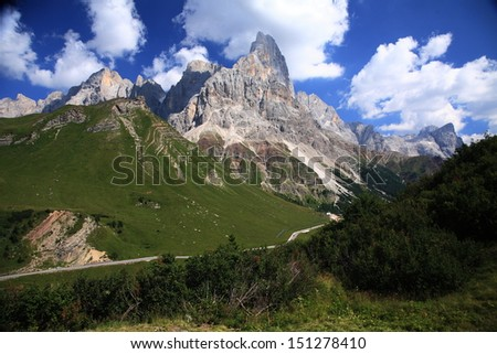 step rolle and mountains Pale di San Martino Dolomites - stock photo