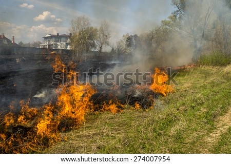 steppe fire in the fields, the wall of smoke - stock photo