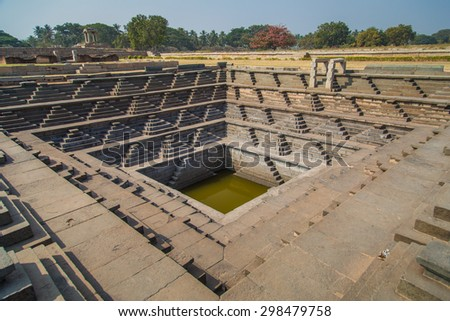 Stepped tank and ruins of Hampi, a UNESCO World Heritage Site, India. - stock photo