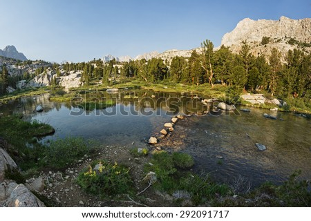 stepping stones on a trail across a stream in the Sierra Nevada Mountains