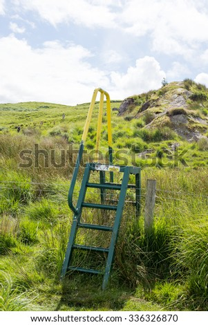 steps and handrail over a ditch for walkers on the kerry way in ireland - stock photo