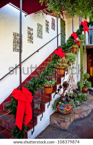 steps and stairs christmas wreath decorations red ribbons cactus old san diego town california