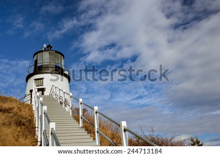 Steps leading up from the Light keepers quarters up to the Owls Head Lighthouse - stock photo