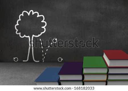 Steps made of books in front of tree doodle on blackboard