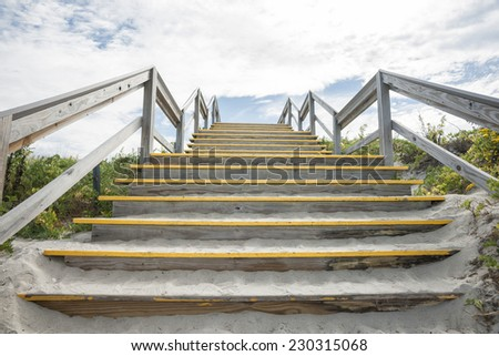 Steps over the and protecting the dunes at Crane beach, Massachusetts, USA - stock photo