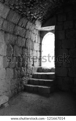 Steps to the light. Nimrod Fortress, Israel. B&W - stock photo