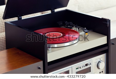 Stereo Audio Music Turntable Vinyl Record Player in Rack Closeup - stock photo