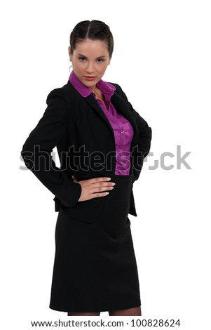 Stern businesswoman stood with hands on hips