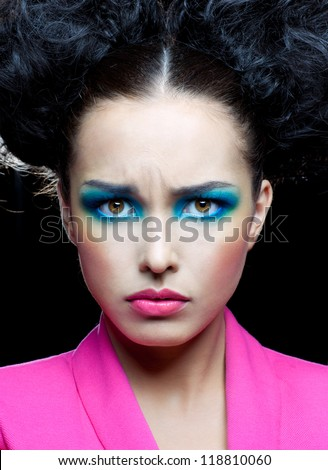 Stern look on the face of beautiful girl - stock photo