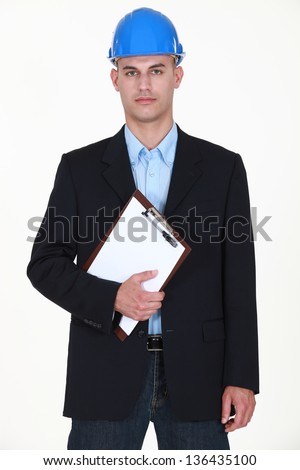 Stern looking site inspector - stock photo