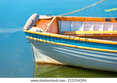stern of a boat on the lake closeup - stock photo