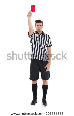 Stern referee showing red card on white background - stock photo