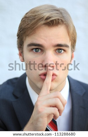 Stern Secretive Attractive Young Professional Businessman Man (Be Quiet) - stock photo