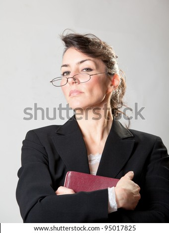 Stern Sunday school teacher with her bible - stock photo