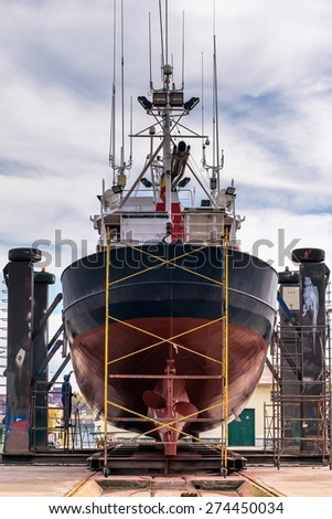 Stern view of a fishing boat in a shipyard for maintenance - stock photo