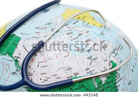 Stethescope and Globe - stock photo