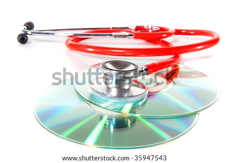 Stethoscope and a cd disk - checking the content of the disk. Could be used for medical and computer purposes! - stock photo