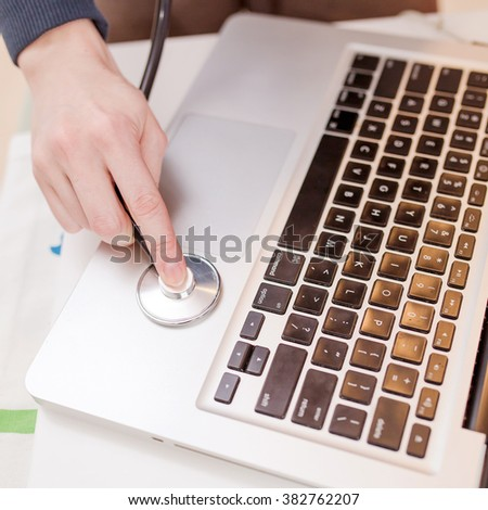 Stethoscope and a laptop