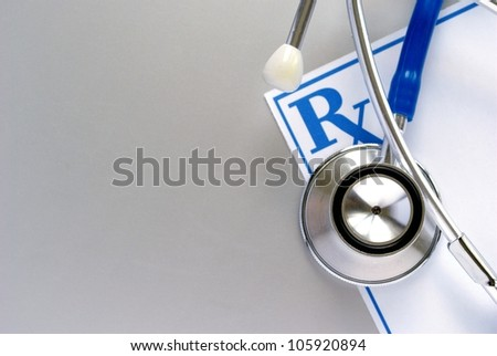 stethoscope and a prescription form, and space for your message - stock photo