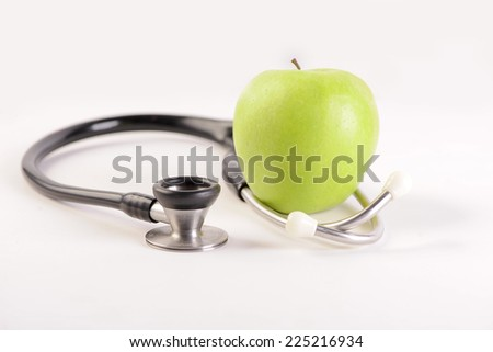 Stethoscope and apple   - stock photo