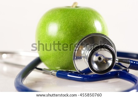 Stethoscope and Apple on a white background - stock photo