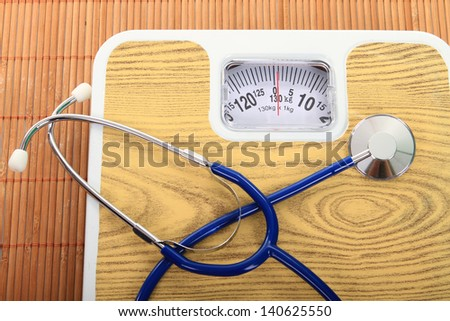 stethoscope and balance symbol photo for weight control - stock photo