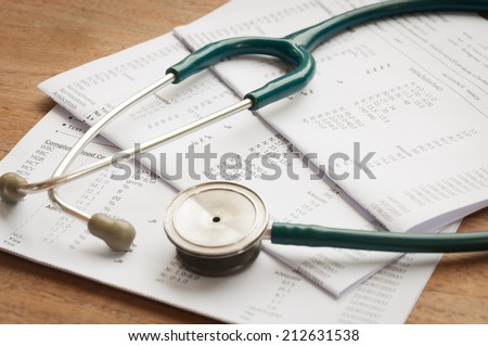 Stethoscope and blood test results - stock photo