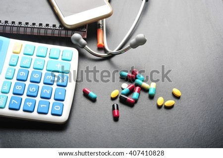 Stethoscope and calculator symbol for health care costs or medical insurance.