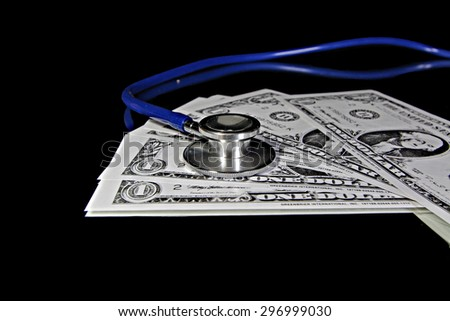 Stethoscope and dollar bills