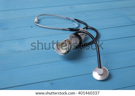 stethoscope and dollars
