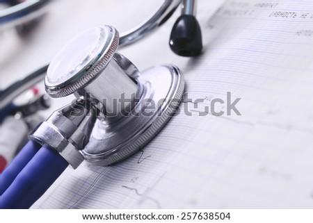 Stethoscope and ECG macro concept diagnostics - stock photo
