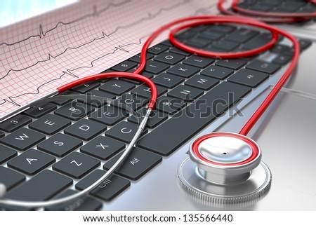 Stethoscope and ECG on laptop keyboard - stock photo