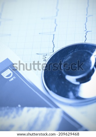Stethoscope and ECG paper. close-up photo  - stock photo