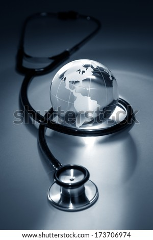 Stethoscope and Globe, concept of World Problems - stock photo