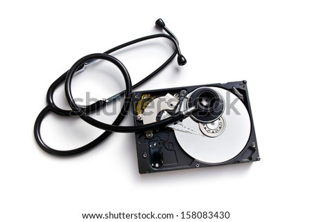 stethoscope and hard disk on white background