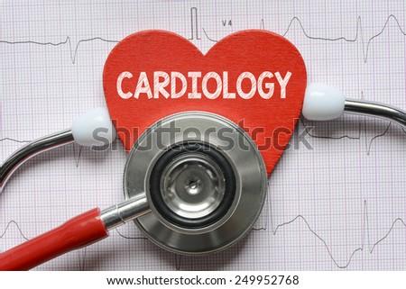 Stethoscope and heart symbol. Cardiogram background with stethoscope and heart symbol - stock photo