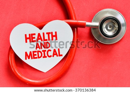 Stethoscope and heart symbol with inscription Health and Medical on red background - stock photo