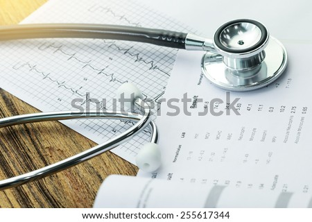 Stethoscope and medical check-up report for healthcare concept - stock photo