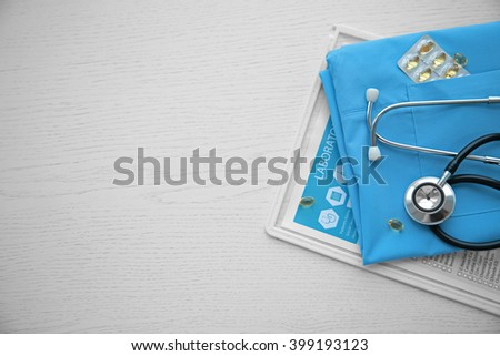 Stethoscope and medical equipment on a light blue background